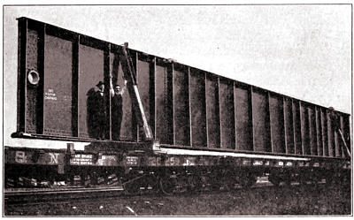 Two Men and a Floor Beam: In Transport To Site On Railroad Car